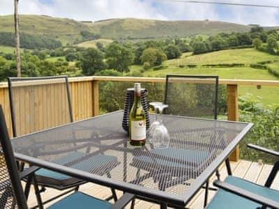 Decked terrace overlooking panoramic scenery | Wern Ddu Cottage, Penybontfawr, near Oswestry
