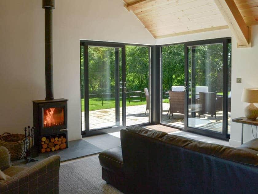 Lovely oak timber living area with large glazed windows | Daffodil - Lower Millcombe Barns, Linkinhorne, near Callington