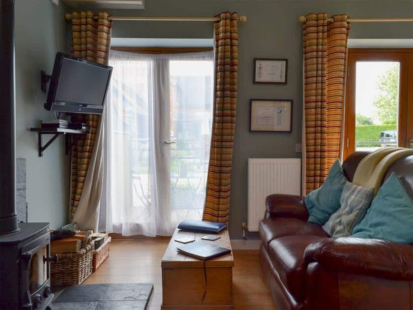 Living room with wood-burning stove | Saddle Room - Higher Farm, Martin, Fordingbridge