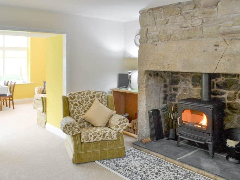 Feature fireplace in living room | Holystone Estate - Hazelnut Cottage - Holystone Estate, High Farnham, near Rothbury