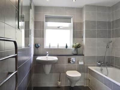 Bathroom with shower over bath and heated towel rail | 8 Military Drive - Military Drive, Portpatrick, near Stranraer