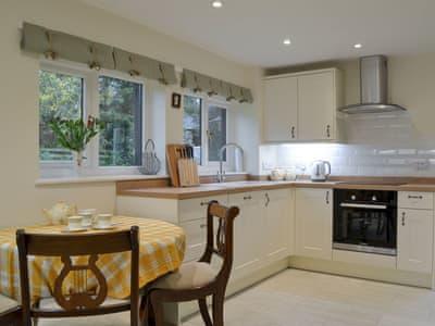 Kitchen with dining area | Smithy House, Bampton Grange, near Pooley Bridge