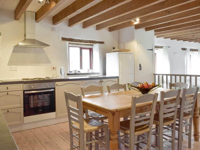 Wood beamed ceiling throughout the open-plan living space | Rose Barn - Rosehill Farm, Llangoedmor, near Cardigan