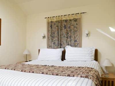 Relaxing double bedroom | Plum Tree Cottage, St Fillans, Loch Earn