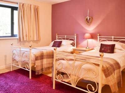 Delightful twin bedroom with antique style beds | Waterhead Studio, Near Ambleside