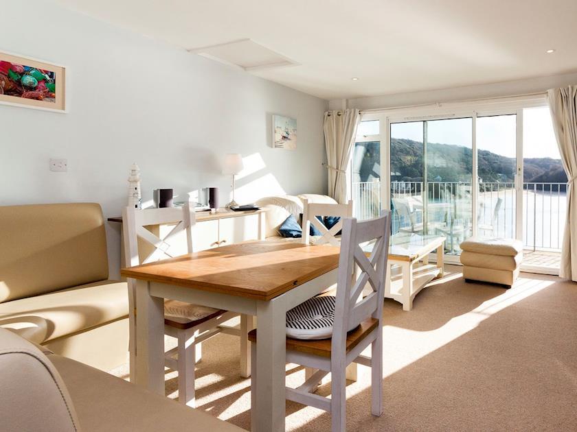Living area with doors leading to balcony | Upper Deck, Salcombe