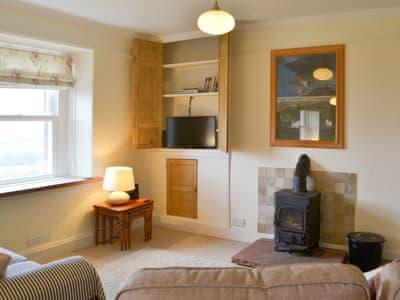 Tastefully furnished living/dining room with wood burner | Loadpot, Ullswater