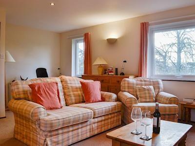 Cosy and welcoming open plan living area | Melbreak, High Lorton, near Cockermouth