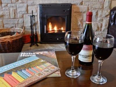 Welcoming wood burner in the living room   Bryn Euryn Cottage, Rhos-on-Sea, near Colwyn Bay