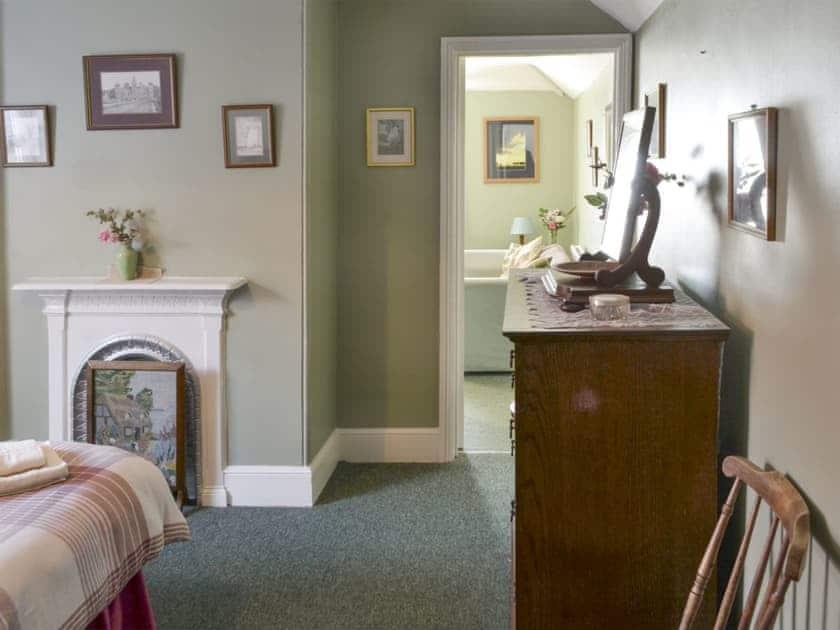 Comfortable double bedroom adjoins the living area | Ranworth - Beverley House, Cromer