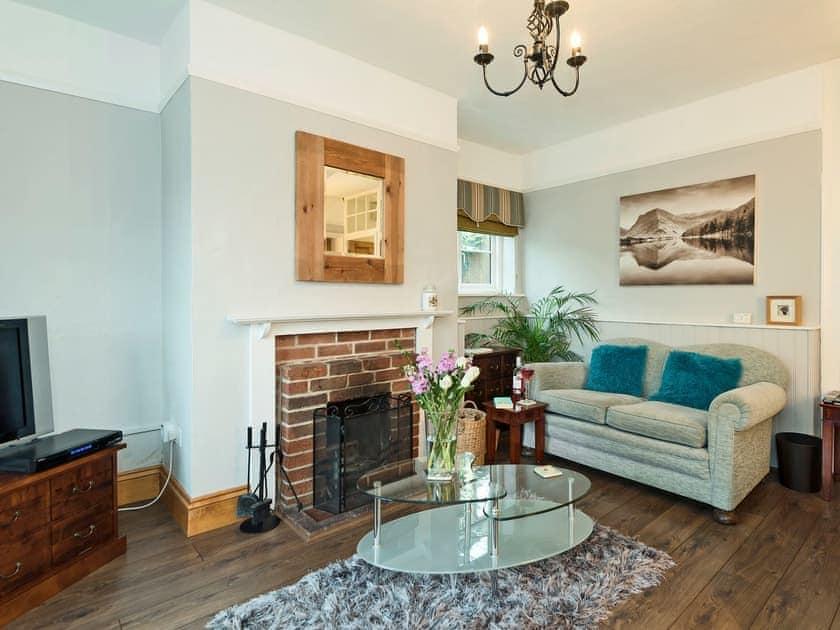 Stylishly furnished living room with open fire | Horseshoes House, Saham Toney, near Thetford