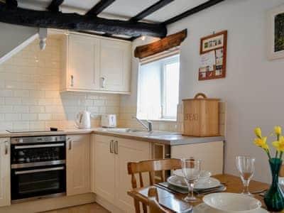 Modest kitchen area and adjacent dining area | Osprey Cottage, Bassenthwaite