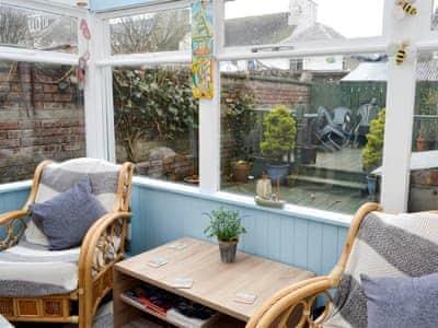 Sun room with additional furniture | Portside Cottage, Portpatrick