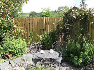 Sitting out area within garden | Croft Corner - Croft House Cottages, Applethwaite, near Keswick
