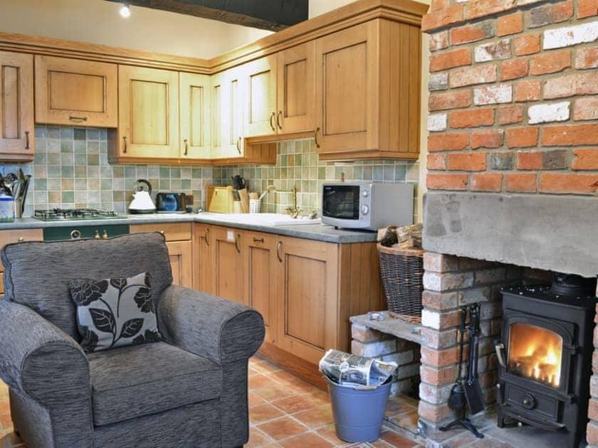 Farmhouse-style kitchen area | The Stable - Bridge Farm Holiday Cottages, Brigham