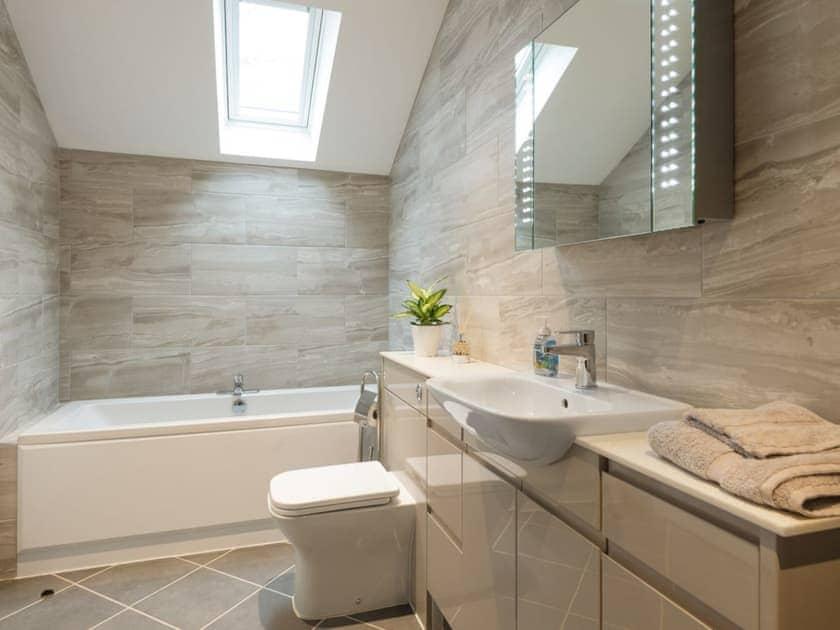 En-suite bathroom with bath, walk-in shower, toilet and heated towel rail | Bay Cottage, Boughton, near Downham Market