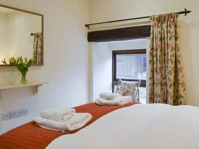 Elegant double bedroom with en-suite shower room | Tythe Barn, Grindleford