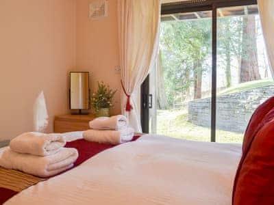 Delightful double bedroom with sliding patio doors to the garden and grounds | Squirrels, Neaum Crag, Skelwith Bridge