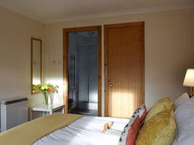 Spacious double bedroom with en-suite shower room | Tamarisk, Nethy Bridge
