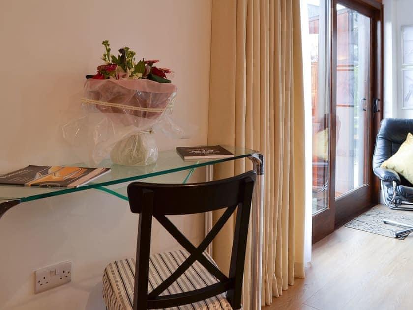Pretty console table in the living area | Windmill Barn, Windmill Hill, near Hailsham