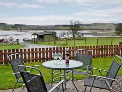Peaceful sitting-out-area with wonderful waterside views | Silver Dee, Crossmichael, near Castle Douglas