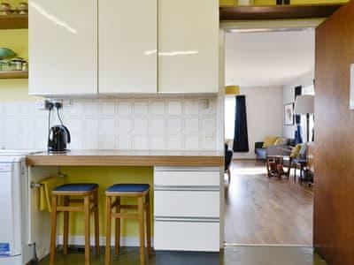 Useful breakfast bar within kitchen | How Dyke, Setmurthy, near Cockermouth