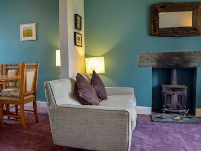 Homely living/dining room | Crookthwaite Cottage, Hawkshead, near Ambleside