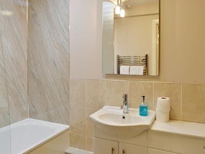 Family bathroom with shower over bath | Bute - Portpatrick Holiday Homes, Portpatrick, near Stranraer