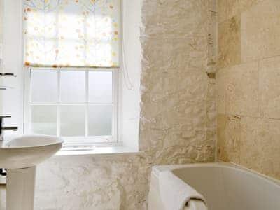 En-suite bathroom with shower over bath   The Mill Race, Applethwaite near Keswick