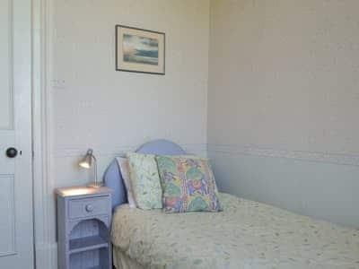 Single bedroom | Tirril Lodge, Tirril, Ullswater