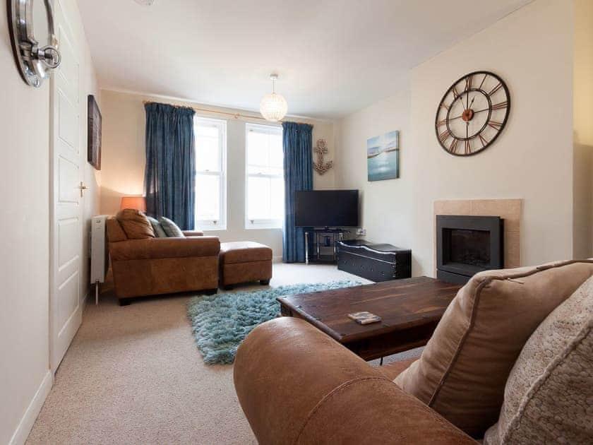 Delightful living room with contemporary fireplace   Quarter Deck, Dartmouth