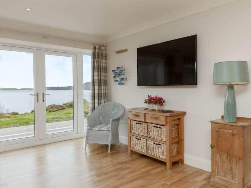 Light and airy living area | Kames Beach House, Kilmelford, near Oban