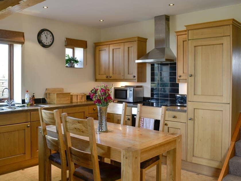 Well equipped kitchen/ dining area | Hutter Hill Barn West, Silsden near Skipton