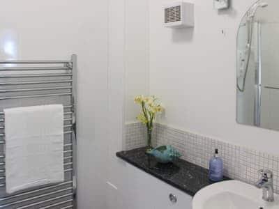 Family bathroom with shower over bath | Bunnyhops - Spey Bay Lodges, Spey Bay, near Fochabers