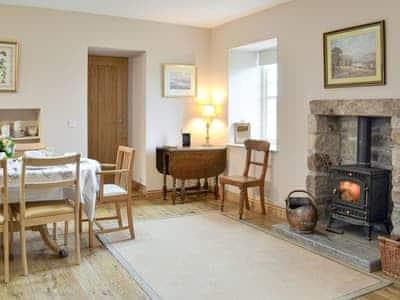 Warming wood burner within the dining area | Gardener's Cottage, Aberlady, near Gullane