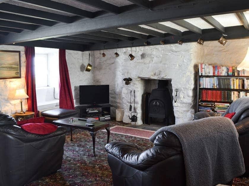 Living room with wood burner | Porth Colmon Farmhouse, Porth Colmon, near Pwllheli