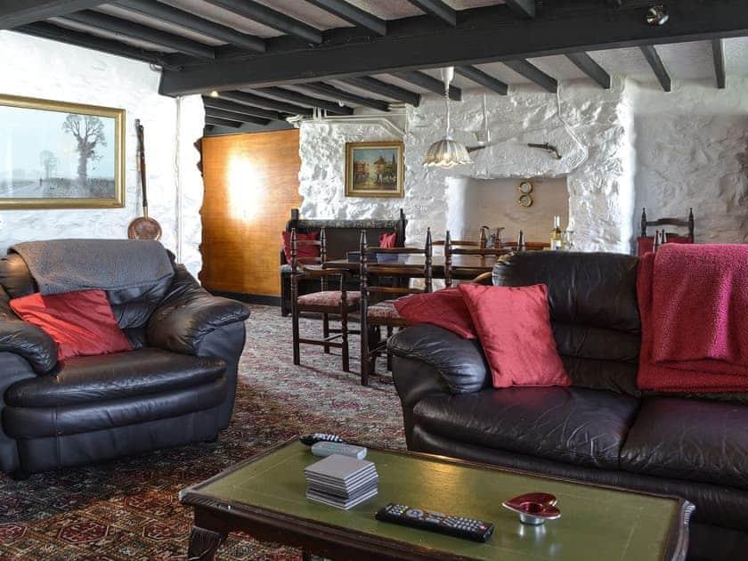 Living room with dining area | Porth Colmon Farmhouse, Porth Colmon, near Pwllheli