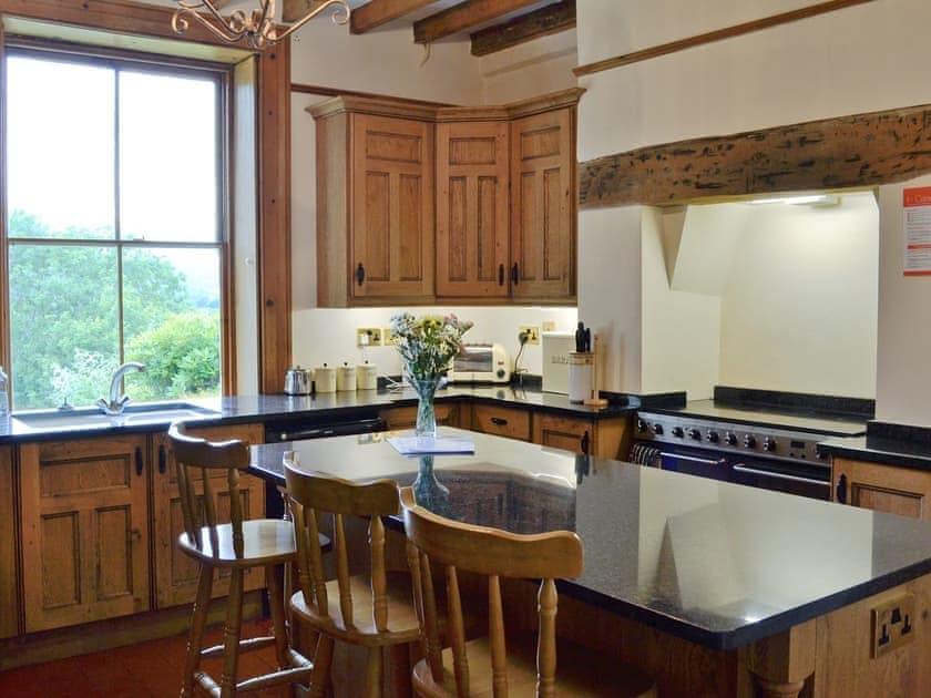 Well-equipped fitted kitchen with 'island' feature   Bryn Rhydd, Maenan, near Llanrwst