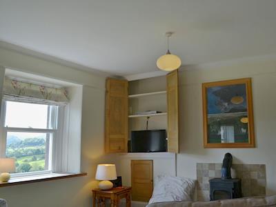 Tastefully furnished living/dining room with wood burner   Loadpot, Ullswater