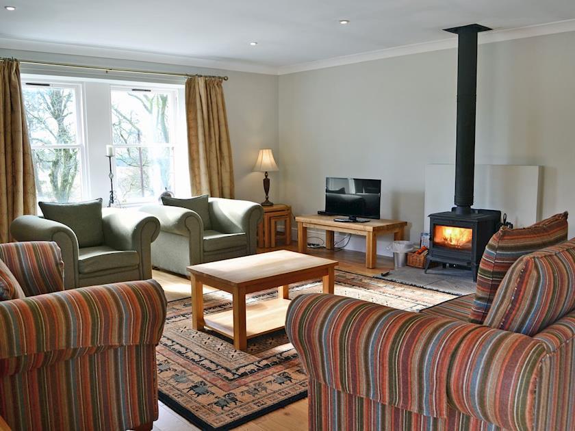 Spacious living room with wood-burning stove | Beech Cottage - Mountherrick Holiday Cottages, Crawfordjohn, near Biggar