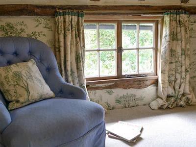 Quiet seating area on landing | The Cottage - Dolgenau, Llawr-y-Glyn, Caersws