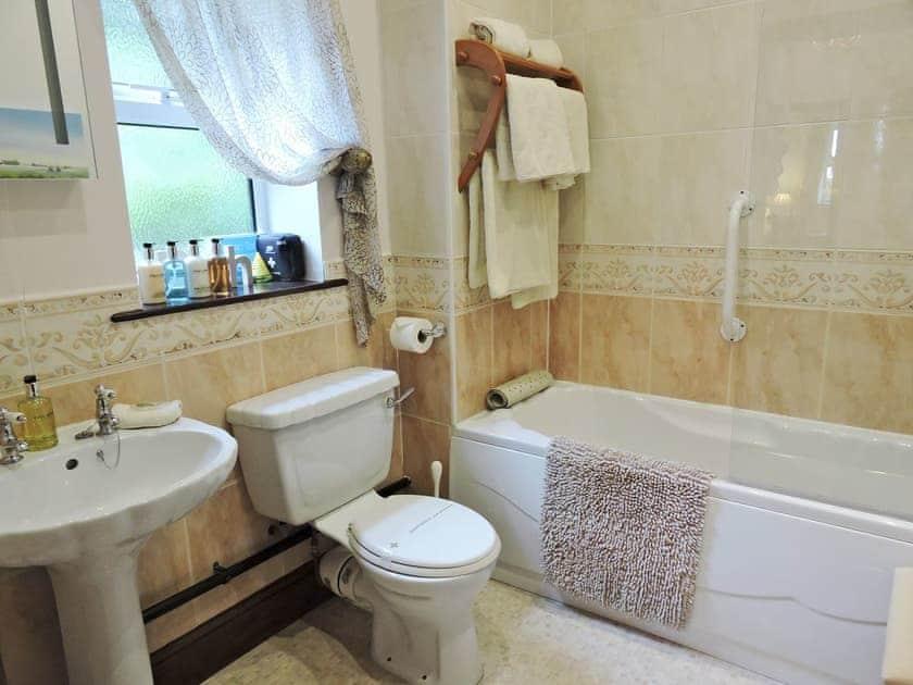 Bathroom with three piece suite and shower over bath | Moorlands Cottage, Levisham