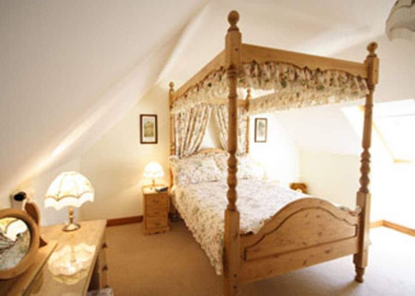 Gable Barn four poster bed | Gable Barn, Runcton Holme