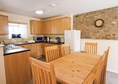 Smithy Barn dining and kitchen area | Smithy Barn, Betws-Yn-Rhos, Conwy