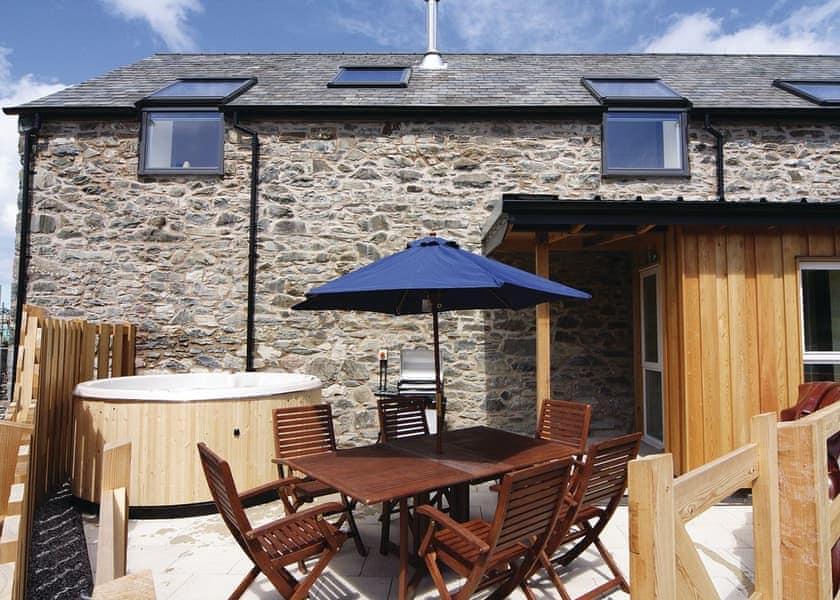 Smithy Barn patio and hot tub | Smithy Barn, Betws-Yn-Rhos, Conwy