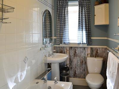 Family bathroom with shower over bath | Manse Cottage, Corstorphine, Edinburgh