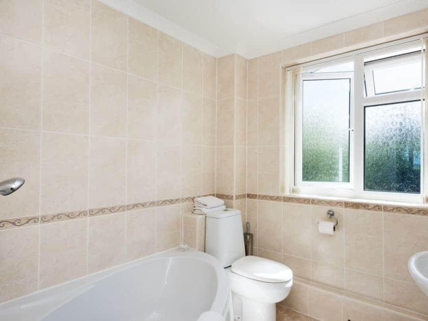 Bathroom with corner bath | Camelot, Weybourne, near Holt