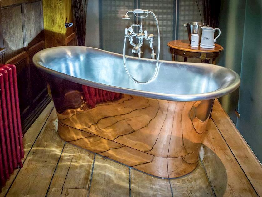 En-suite bathroom featuring chromotherapy spa bath | Lendal Tower, York