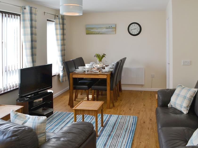 Spacious living/ dining room | Villa 55, Cromer