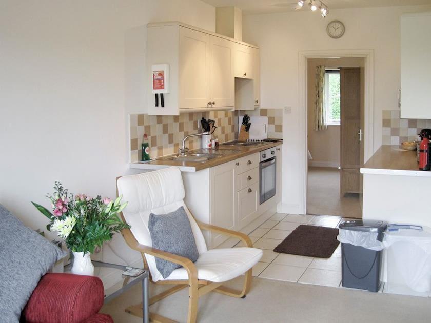 Open-plan design includes a well-equipped kitchen | Chaplin - Tathwell Lodge, Little Tathwell, near Louth